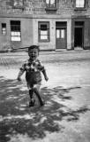 Joseph Watt in the street outside his tenement hoime at 70 St Leonard Street, around 1953.