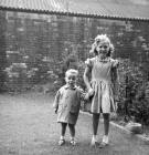 Forbes Wilson and his Cousin, Lorraine,  in a back garden at 28 Thorntree Street, Leith  -  1960