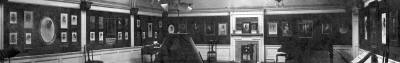Zoom-in to see the photographs on the walls of Louis Saul Langfier's studio.  Was this in Glasgow or Edinburgh or London?